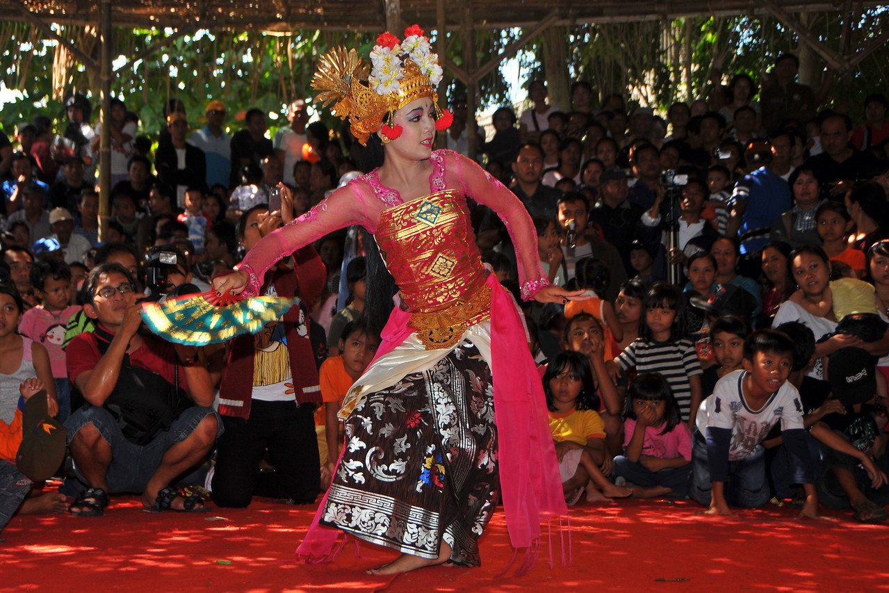 "Ms. Putu (Ms. Riskiana Dewi), was the  Balinese dancer who performed at the Bali Art Festival (Pesta Kesenian Bali) at Denpasar, Bali. June, 2009 and presented the social dance Joged Bumbung. It was presented by Winagun Semara Mendoyo Dangin Tukad Vilalge Jembrana Regency at 11.00 am on 25th June 2009 at the Ayodya Stage.<br /> <br /> Bali Art Center is located on Nusa Indah Street, about 2 Kms distance from the City Centre or Puputan Badung Park. The Art Centre was officially opened in February 14th, 1973. The Art Centre is a building - complex with Balinese traditional architecture with an extent of about 5 hectares consisted of: Exhibition Hall called Mahudara Mandhara Giri Bhuana where paintings and other traditional Balinese objects are exhibited. The Hall is located on the north side of the Art Centre Complex. The Ksirarnawa Hall, a two-storey hall in which various kinds of performing arts are on stage on the upper floor white exhibitions of handicrafts, gold and silverworks are held on the first floor. The Ardha Candra open stage is located on the Eastern side, on which traditional performing-arts, music-concerts and fashion-shows are often held, The Wantilan Hall is also used for similar purpose. The Art Centre had the Arts festival going on when we visited. <br /> See more details at:  <a href=""http://www.baliartsfestival.com/"">http://www.baliartsfestival.com/</a>"