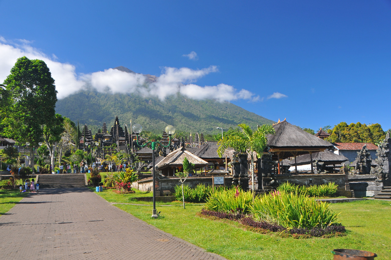 "The Mother Temple of Besakih - Pura Besakih in the village of Besakih on the slopes of Mount Agung in eastern Bali, is the most important temple of Agama Hindu Dharma in Bali, Indonesia and is one of a series of Balinese temples. It has been nominated as an UNESCO World Heritage Site.<br /> <br /> A series of eruptions of Mount Agung in 1963, which killed approximately 1,700 people also threatened Puru Besakih but fortunately, the lava flows missed the temple complex by mere yards. The saving of the temple is regarded by the Balinese people as miraculous, and a signal from the Gods.<br /> <br /> This temple was built in a holy village named Hulundang Basukih, which is known today as Besakih village. The name of Besakih was derived from the word ""Basuki"" or in some old manuscripts written as Basukir or Basukih. The word Basuki itself was taken from the word ""Wasuki"" on the Sunskrit, which means ""salvation"".<br /> <br /> The mythology of Samudramanthana mentioned that Basuki was the name of a dragon that coiled around the Mandara Mountain.<br /> <br /> The old remains say that the Besakih Temple was built by Rsi Markandya and his followers in the 11th century. At that time, Rsi Markandya intended to go to Mount Agung to build a residence. The construction was troubled by a disease which caused the death of his followers. For the safety of them, he constructed a veneration to worship God for a salvation. The veneration was called ""Sanggar Basuki""."
