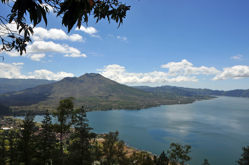 View of Mount Batur & Lake Batur - Penelokam<br /> Mount Batur (Gunung Batur) is an active volcano located north west of Mount Agung, Bali, Indonesia.<br /> <br /> Mount Batur is a perfect volcanic experience which attracts thousands of tourists every year. An hour's drive from Ubud, Mount Batur is considered sacred by the Balinese and is one of the world's most active volcanoes leading to a strange pristine wilderness. The locals largely rely on agriculture for income but tourism has become increasingly popular due to the relatively straightforward trek to the summit of the central crater.<br /> <br /> The lake, Danau Batur, is the largest crater lake on the island of Bali and is a good source of fish.