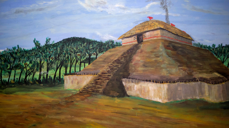 This painting illustrates how Mound C might have looked when it was used as a platform for a building. The building was probably an ossuary for the bones of the elite/leaders of the community. The painting is by archeologist Robert Neitzel, one-time curator of this site.