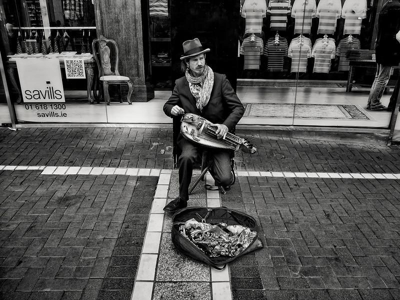 Musician and his Hurdy gurdy on the streets of Dublin Town.  Dublin, Ireland, 2013.