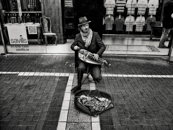 Musician and his Hurdy gurdy on the streets of Dublin Town.  Dublin, Ireland, 2013.