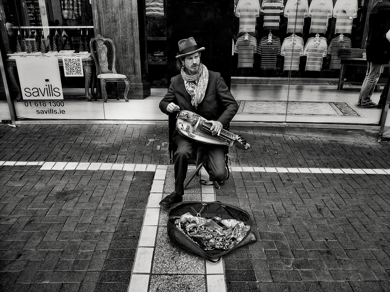 Musician and his Hurdy gurdy on the streets of Dublin Town.<br /> <br /> Dublin, Ireland, 2013.