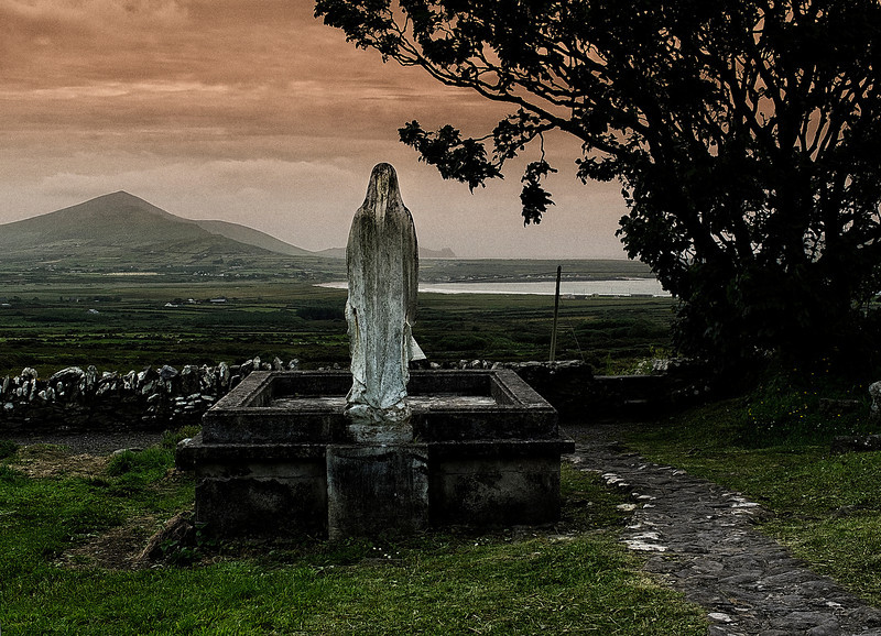 Holy Mary at a graveyard.<br /> <br /> Ireland, 2013.