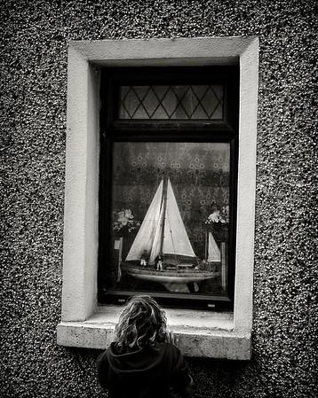 Boy and a boat.  Cobh, Ireland, 2013.