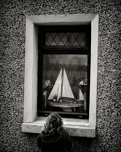 Boy and a boat.  Cobh, Ireland, 2013.