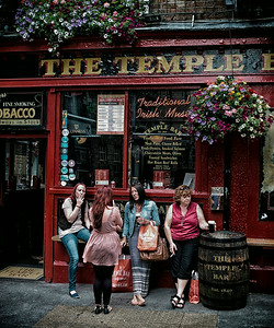 Friends outside a popular Pub in Dublin.  Dublin, Ireland, 2013.