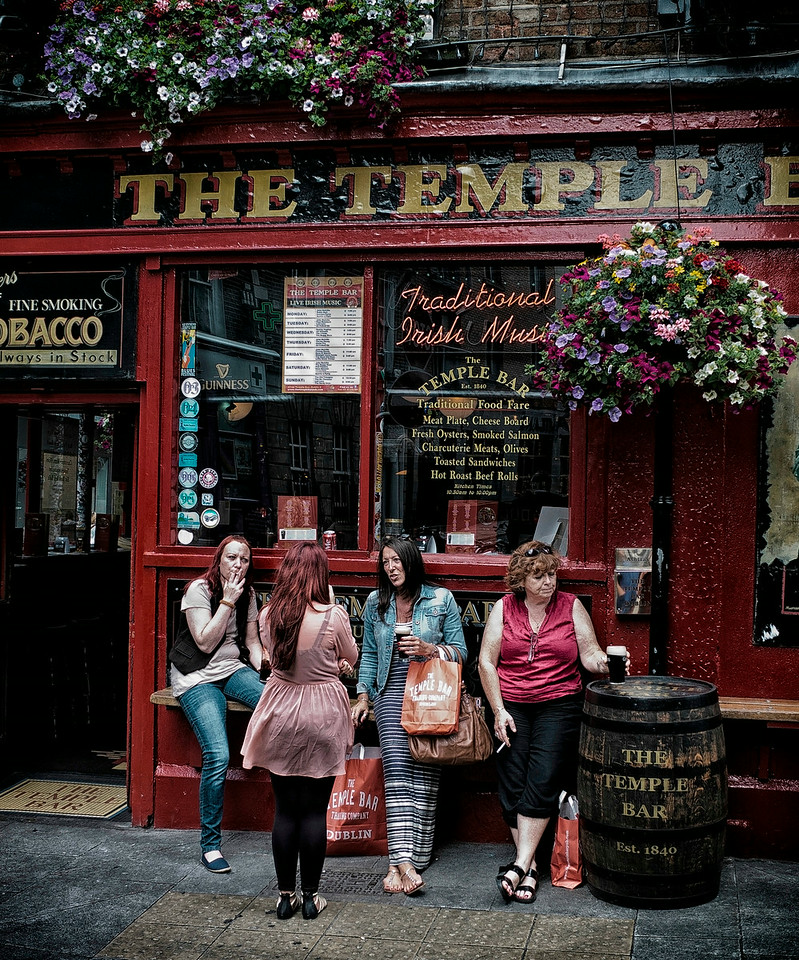 Friends outside a popular Pub in Dublin.<br /> <br /> Dublin, Ireland, 2013.