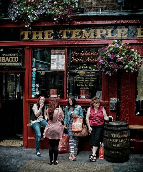 Friends outside a popular Pub in Dublin.<br /> <br /> Dublin, Ireland, 2013.