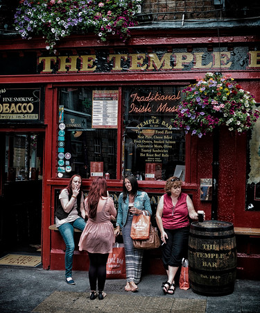 Friends outside a popular Pub in Dublin.  Dublin, Ireland, 2013.