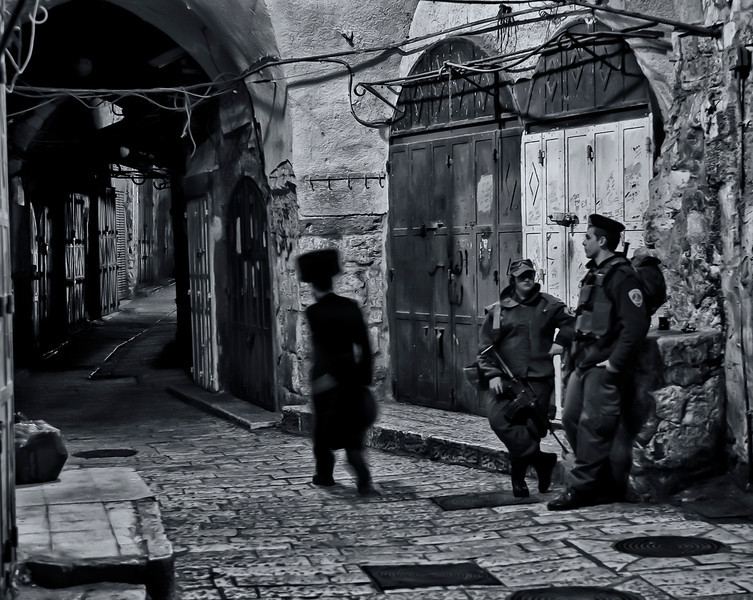 Soldiers of the IDF on security duties in the Muslim quarter protecting the Jews as they make there way to the wailing wall.<br /> <br /> Jerusalem, Israel, 2012.