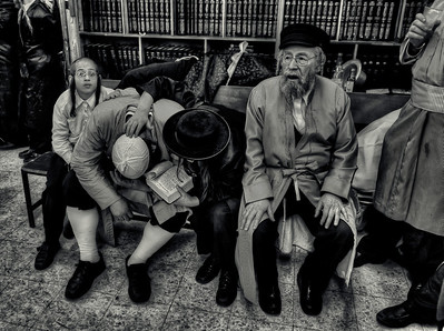 "Son consoles his drunken father with the use of the Torah at a synagogue during the festival of Purim.  For more on drinking during Purim please visit ""the people of Mea Shaerim"" under the ""meet the people"" gallery.  Mea Shaerim, Jerusalem,Israel, 2012"