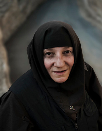Natasha 53 is a Serbian Christian nun serving in the Russian monastery on the Mount of Olives. Natasha decided to give up her career as a pharmacist and her passion for karate and karaoke to join the monastery at the age of 41.   Jerusalem, Israel, 2012.