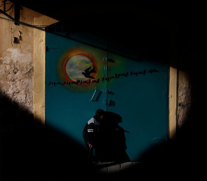 Arab boy peeping through a key hole.<br /> <br /> Akko, Israel, 2012.
