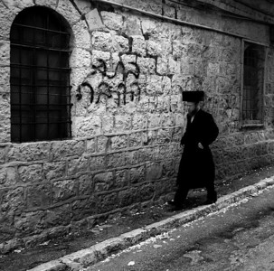 "Haredim walking along the streets of Mea Shearim.   For more on Mea Shearim please visit ""the people of Mea Shaerim"" under the ""meet the people"" gallery.  Mea Shearim, Jerusalem, Israel, 2012."