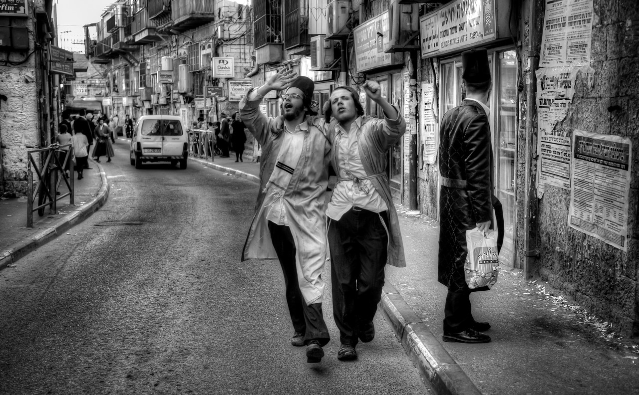 """Drunk Haredim youths celebrating the festival of Purim along the streets of Mea Shearim.<br /> <br /> For more on Purim please visit """"the people of Mea Shaerim"""" under the """"meet the people"""" gallery.<br /> <br /> Mea Shearim, Jerusalem, Israel, 2012."""