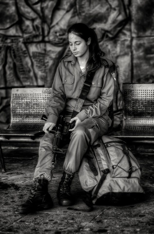 Ajdot 18 is currently doing her military service with the IDF. She waits for the bus early in the morning at the bus station in the Arab town of Akko. From here she will travel buy public bus to the border with Lebanon where she will carry out observation duties on the hostile neighbor. Although she is required to do a minimum of two years service, Ajdot would like to go for promotion and serve for an extra two years.<br /> <br /> Akko, Israel, 2012.