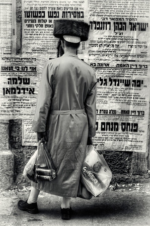 With no TV, radio or internet the residents of Mea Shearim rely on street advertising for local news and events mostly of a religious nature.   Mea Shearim, Jerusalem, Israel, 2012.