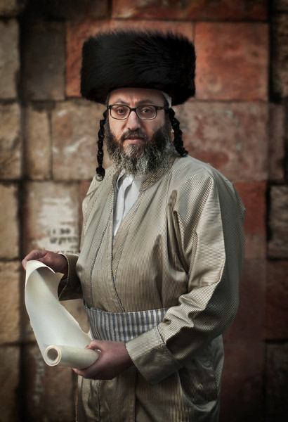 A Haredim holding a copy of a hand written text about Purim.