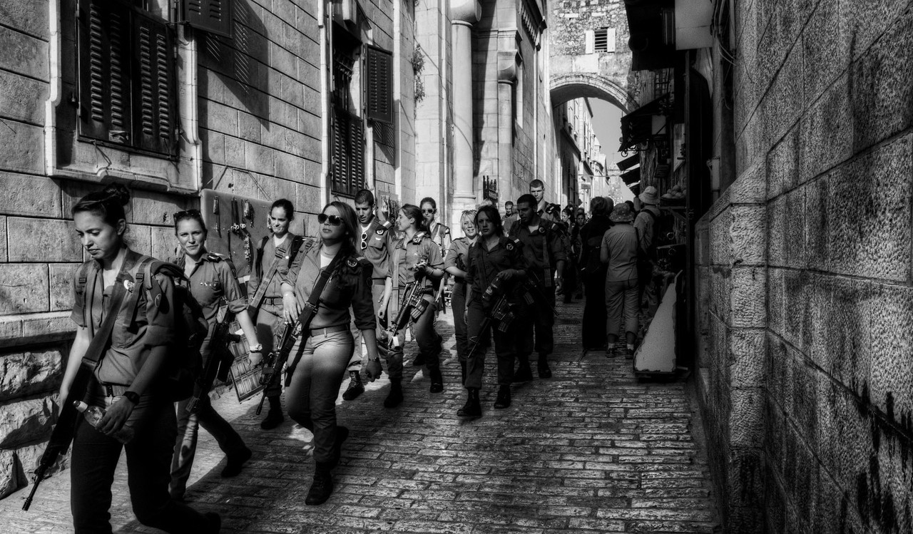 Women of the Israeli Defence Force make there way into the old walled city of Jerusalem to start there shift keeping the peace between the differant religious groups.  <br /> <br /> Jerusalem, Israel, 2012.