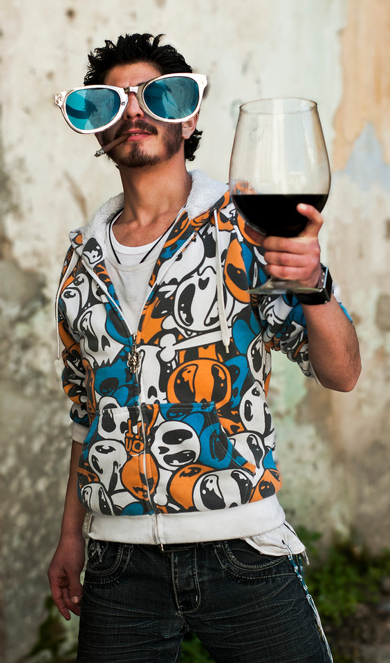 """Young Jewish man getting drunk on port wine during the Purim Celebrations. <br /> <br /> For more on drinking during Purim please visit """"the people of Mea Shaerim"""" under the """"meet the people"""" gallery.<br /> <br /> Jerusalem, Israel, 2012."""