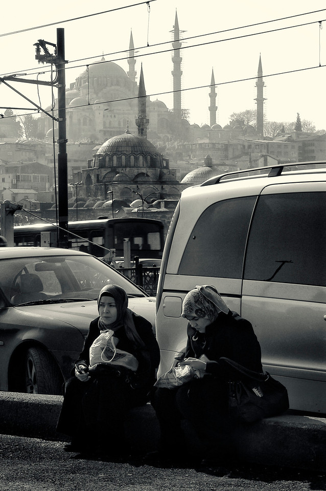 Women having a snack between the busy city traffic.<br /> <br /> Istanbul, 2009.