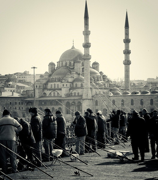 Men fishing from the Galata Bridge.<br /> <br /> Istanbul, 2009.
