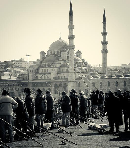 Men fishing from the Galata Bridge.<br /> <br /> Istanbul, 2009.