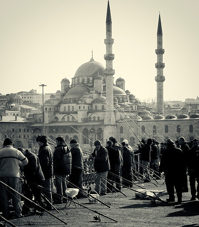 Men fishing from the Galata Bridge.  Istanbul, 2009.