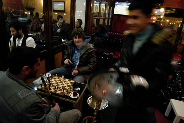 Backgammon is very popular in Istanbul, seen all over the city, in almost every cafe and played by people of all ages.  Youngsters playing backgammon in the popular area of Tophane.