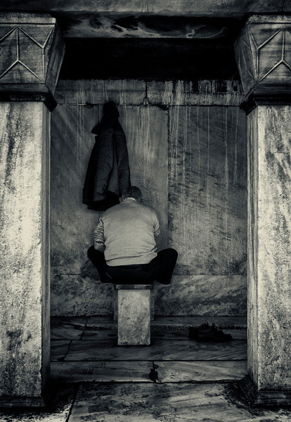 Worshiper cleaning his feet before prayer at the Sultan Ahmed Mosque. <br /> <br /> Istanbul, 2009.