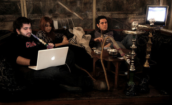 Youth smoking narghile whilst surfing the net in Tophane.  Istanbul, 2009.