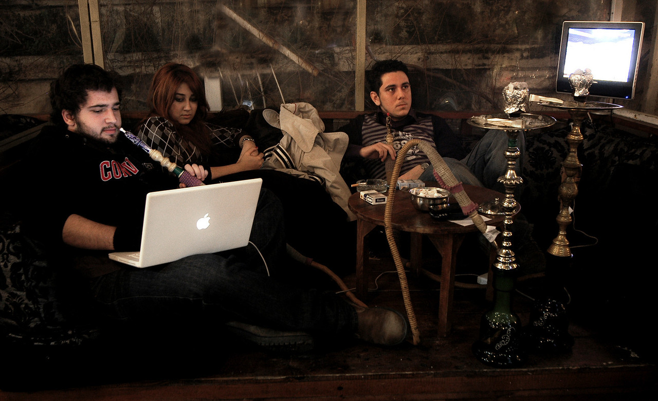 Youth smoking narghile whilst surfing the net in Tophane.<br /> <br /> Istanbul, 2009.