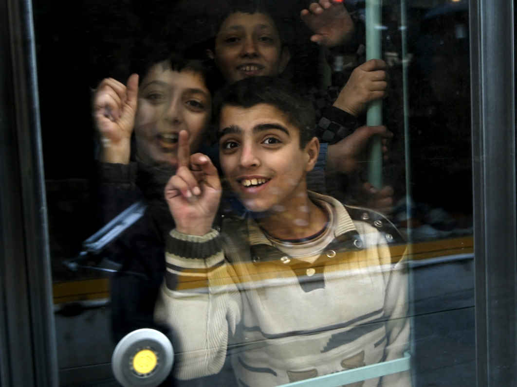 Local boys inside the tram that runs almost the entire length of Istiklal Street, one of the longest streets in Europe.<br /> <br /> Istanbul, 2009