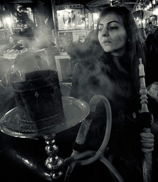 Young women smoking narghile in Tophane.<br /> <br /> Istanbul, 2009.
