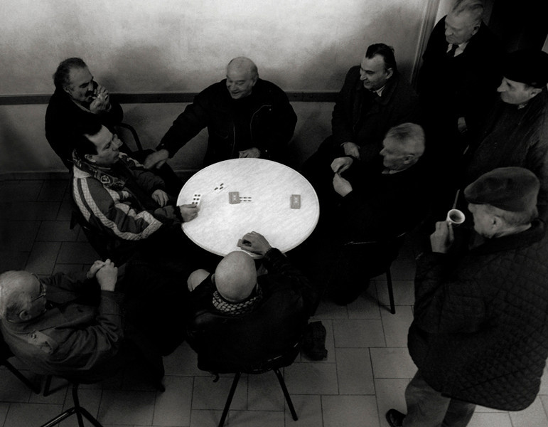 Local men playing cards in a cafe.<br /> <br /> small mountain village, northern Italy.
