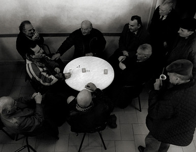 Local men playing cards in a cafe.  small mountain village, northern Italy.