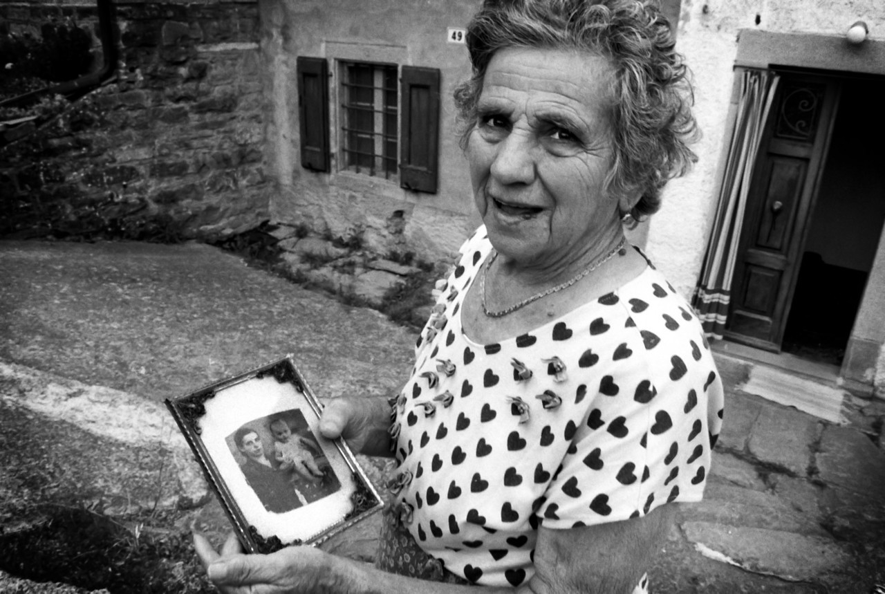 Local woman shows photographs of family gone missing during Benito Mussolini grip on power in Italy.<br /> <br /> Small mountain hamlet, northern Italy.