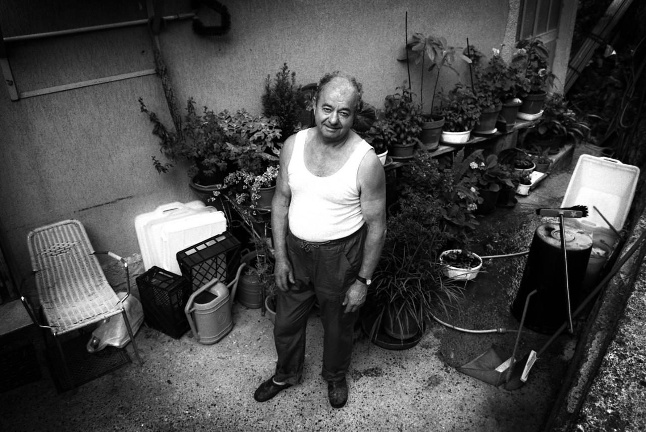 Man in his patio. <br /> <br /> Genoa, Italy