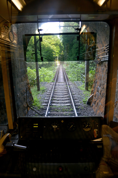 The Hakone Tozan Cable Car (箱根登山ケーブルカー), officially the Cable Line (鋼索線) is a funicular railway, in the town of Hakone, Kanagawa Prefecture, Japan. It is operated by Hakone Tozan Railway. The funicular links Gōra, the upper terminus of the railway line, with Sōunzan 214 metres (702 ft) above. At Sōunzan, connection is made with the Hakone Ropeway, which runs to Tōgendai on Lake Ashi. The line was opened in 1922, and was rebuilt in 1995 and new cars replaced the old cars at the same time.<br /> <br /> Hakone (箱根町) is a town in Ashigarashimo District in Kanagawa Prefecture, Japan. Hakone is located in the mountainous far west of the prefecture, on the eastern side of Hakone Pass. Most of the town is within the borders of the volcanically active Fuji-Hakone-Izu National Park, centered around Lake Ashi. Hakone is the location of a noted Shinto shrine, the Hakone Gongen, which is mentioned in Heian period literature. Hakone is noted for its onsen hot spring resorts, which attract both Japanese and international visitors due to its proximity to the greater Tokyo metropolis and to Mount Fuji. Hakone is a very popular tourist destination and best accessed from Odawara.