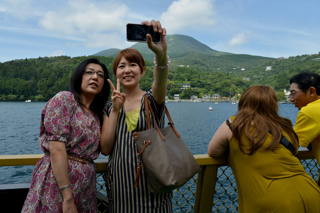 Tourists enjoy a boat ride in Hakone at Lake Ashi.<br /> <br /> Hakone (箱根町) is a town in Ashigarashimo District in Kanagawa Prefecture, Japan. Hakone is located in the mountainous far west of the prefecture, on the eastern side of Hakone Pass. Most of the town is within the borders of the volcanically active Fuji-Hakone-Izu National Park, centered around Lake Ashi. Hakone is the location of a noted Shinto shrine, the Hakone Gongen, which is mentioned in Heian period literature. Hakone is noted for its onsen hot spring resorts, which attract both Japanese and international visitors due to its proximity to the greater Tokyo metropolis and to Mount Fuji. Hakone is a very popular tourist destination and best accessed from Odawara.
