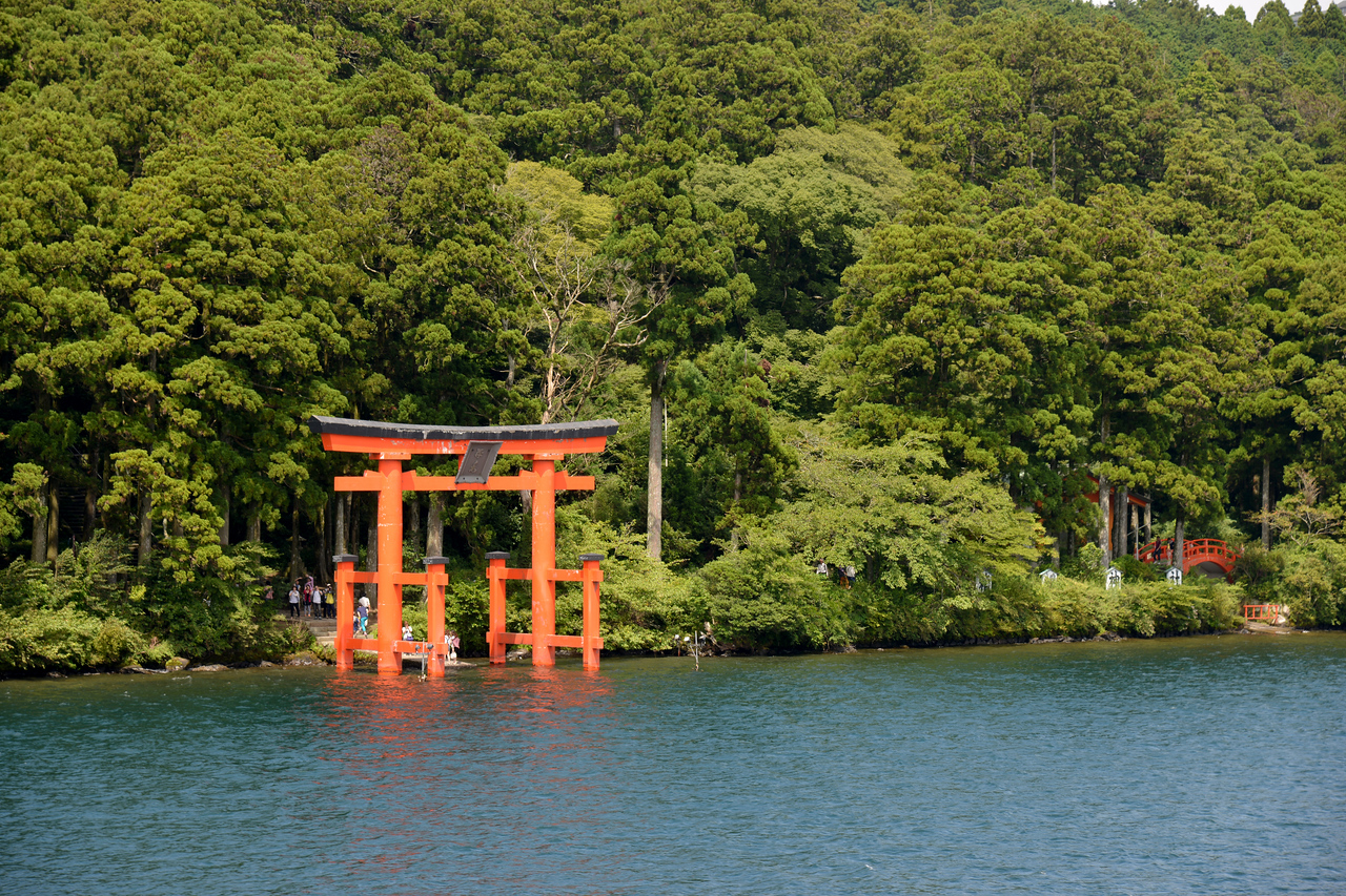 Torii of the shrine in Hakone, at Lake Ashi.<br /> <br /> Hakone (箱根町) is a town in Ashigarashimo District in Kanagawa Prefecture, Japan. Hakone is located in the mountainous far west of the prefecture, on the eastern side of Hakone Pass. Most of the town is within the borders of the volcanically active Fuji-Hakone-Izu National Park, centered around Lake Ashi. Hakone is the location of a noted Shinto shrine, the Hakone Gongen, which is mentioned in Heian period literature. Hakone is noted for its onsen hot spring resorts, which attract both Japanese and international visitors due to its proximity to the greater Tokyo metropolis and to Mount Fuji. Hakone is a very popular tourist destination and best accessed from Odawara.