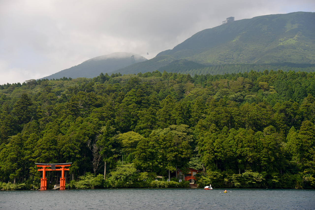 Torii of the shrine in Hakone, at Lake Ashi. Hakone (箱根町) is a town in Ashigarashimo District in Kanagawa Prefecture, Japan. Hakone is located in the mountainous far west of the prefecture, on the eastern side of Hakone Pass. Most of the town is within the borders of the volcanically active Fuji-Hakone-Izu National Park, centered around Lake Ashi. Hakone is the location of a noted Shinto shrine, the Hakone Gongen, which is mentioned in Heian period literature. Hakone is noted for its onsen hot spring resorts, which attract both Japanese and international visitors due to its proximity to the greater Tokyo metropolis and to Mount Fuji. Hakone is a very popular tourist destination and best accessed from Odawara.