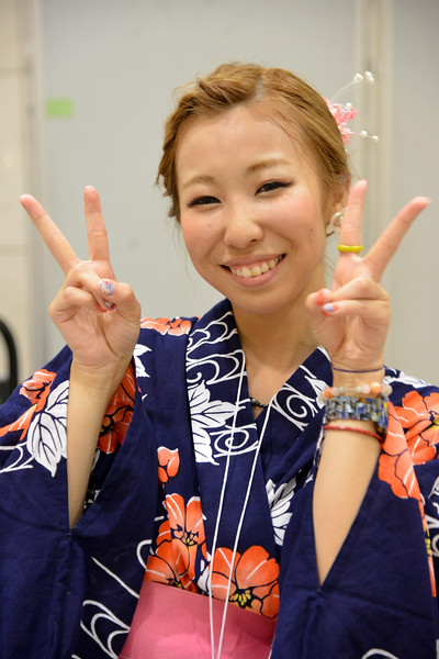 """Japanese lady dressed in the kimono (着物?). Kimono is a Japanese traditional garment. The word """"kimono"""", which literally means a """"thing to wear"""" (ki """"wear"""" and mono """"thing""""), has come to denote these full-length robes. Kimono are T-shaped, straight-lined robes worn so that the hem falls to the ankle, with attached collars and long, wide sleeves. Kimono are wrapped around the body, always with the left side over the right (except when dressing the dead for burial.), and secured by a sash called an obi, which is tied at the back. Kimono are generally worn with traditional footwear (especially zōri or geta) and split-toe socks (tabi).<br /> <br /> Today, kimono are most often worn by women, and on special occasions. Traditionally, unmarried women wore a style of kimono called furisode,[5] with almost floor-length sleeves, on special occasions.<br /> <br /> Hiroshima (広島市) is the capital of Hiroshima Prefecture, and the largest city in the Chūgoku region of western Honshu, which is the largest island of Japan. It is recongnized as the first city in history to be targeted by a nuclear weapon when the United States Army Air Forces (USAAF) dropped an atomic bomb on it at 8:15 a.m. on August 6, 1945, near the end of World War II. Hiroshima is situated on the Ōta River delta, on Hiroshima Bay, facing the Seto Inland Sea on its south side. The river's six channels divide Hiroshima into several islets."""