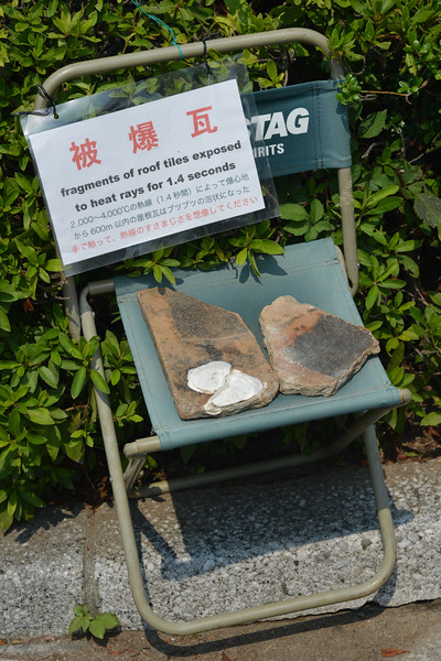 Fragments of roof tiles exposed to heat rays for 1.4 seconds. Hiroshima (広島市) is the capital of Hiroshima Prefecture, and the largest city in the Chūgoku region of western Honshu, which is the largest island of Japan. It is recongnized as the first city in history to be targeted by a nuclear weapon when the United States Army Air Forces (USAAF) dropped an atomic bomb on it at 8:15 a.m. on August 6, 1945, near the end of World War II. Hiroshima is situated on the Ōta River delta, on Hiroshima Bay, facing the Seto Inland Sea on its south side. The river's six channels divide Hiroshima into several islets.