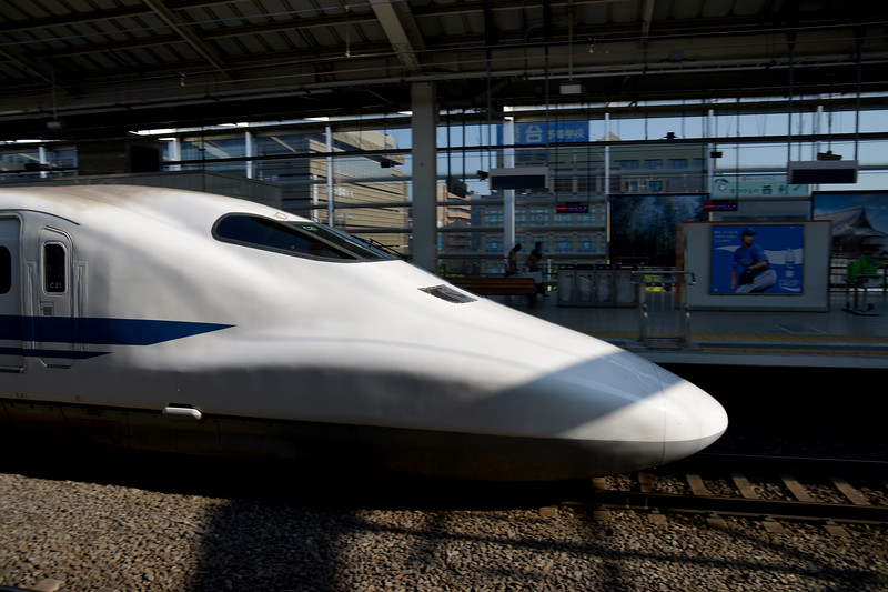 The bullet train arrives into station. The Shinkansen (新幹線) (new trunk line) is a network of high-speed railway lines in Japan operated by four Japan Railways Group companies. Starting with the Tōkaidō Shinkansen (515.4 km) in 1964, the network has expanded to currently consist of 2,387.7 km (1,483.6 mi) of lines with maximum speeds of 240–320 km/h (149–199 mph).<br /> <br /> Kyoto (京都市) is a city located in the central part of the island of Honshu, Japan. It has a population close to 1.5 million. Formerly the imperial capital of Japan for more than one thousand years, it is now the capital of Kyoto Prefecture, as well as a major part of the Kyoto-Osaka-Kobe metropolitan area. With temples, parks, bustling business districts, markets, from regal estates to the tightly-packed neighborhoods, Kyoto is one of the oldest and most famous Asian metropolises. Although ravaged by wars, fires, and earthquakes during its eleven centuries as the imperial capital, Kyoto was spared from much of the destruction of World War II. With its 2000 religious places- 1600 Buddhist temples and 400 Shinto shrines, as well as palaces, gardens and architecture intact, it is one of the best preserved cities in Japan.