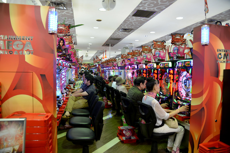 Video games and video parlours and gambling is common entertainment. Seen here at Teramachi Kyogoku.<br /> Kyoto (京都市) is a city located in the central part of the island of Honshu, Japan. It has a population close to 1.5 million. Formerly the imperial capital of Japan for more than one thousand years, it is now the capital of Kyoto Prefecture, as well as a major part of the Kyoto-Osaka-Kobe metropolitan area. With temples, parks, bustling business districts, markets, from regal estates to the tightly-packed neighborhoods, Kyoto is one of the oldest and most famous Asian metropolises. Although ravaged by wars, fires, and earthquakes during its eleven centuries as the imperial capital, Kyoto was spared from much of the destruction of World War II. With its 2000 religious places- 1600 Buddhist temples and 400 Shinto shrines, as well as palaces, gardens and architecture intact, it is one of the best preserved cities in Japan.