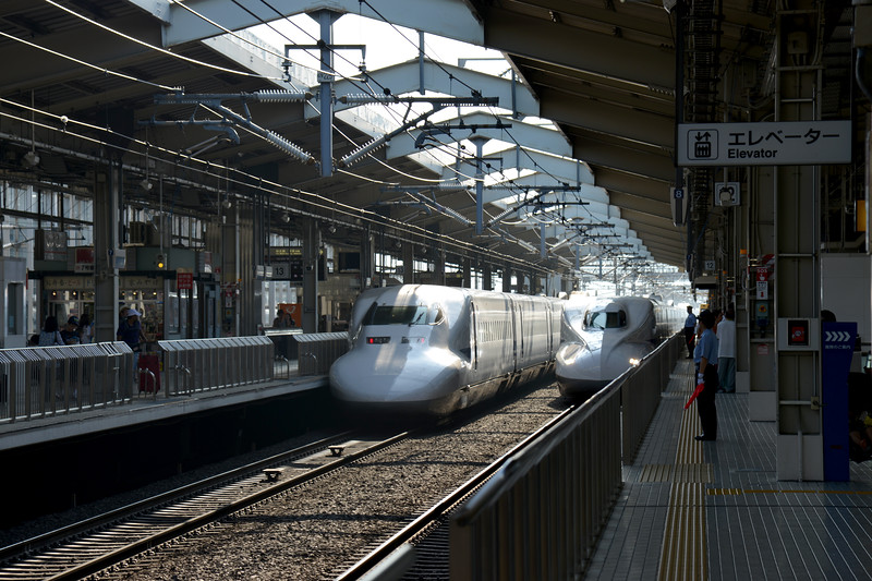 Ttwo Shinkansen trains at the train station. The Shinkansen (新幹線) (new trunk line) is a network of high-speed railway lines in Japan operated by four Japan Railways Group companies. Starting with the Tōkaidō Shinkansen (515.4 km) in 1964, the network has expanded to currently consist of 2,387.7 km (1,483.6 mi) of lines with maximum speeds of 240–320 km/h (149–199 mph).<br /> <br /> Kyoto (京都市) is a city located in the central part of the island of Honshu, Japan. It has a population close to 1.5 million. Formerly the imperial capital of Japan for more than one thousand years, it is now the capital of Kyoto Prefecture, as well as a major part of the Kyoto-Osaka-Kobe metropolitan area. With temples, parks, bustling business districts, markets, from regal estates to the tightly-packed neighborhoods, Kyoto is one of the oldest and most famous Asian metropolises. Although ravaged by wars, fires, and earthquakes during its eleven centuries as the imperial capital, Kyoto was spared from much of the destruction of World War II. With its 2000 religious places- 1600 Buddhist temples and 400 Shinto shrines, as well as palaces, gardens and architecture intact, it is one of the best preserved cities in Japan.