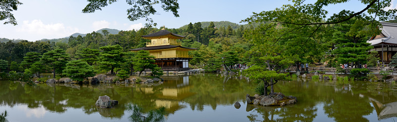 """Kinkaku-ji (金閣寺),""""Temple of the Golden Pavilion"""" is officially named Rokuon-ji (鹿苑寺)  """"Deer Garden Temple"""". It is a Zen Buddhist temple in Kyoto, Japan. The garden complex is an excellent example of Muromachi period garden design. The Muromachi period is considered to be a classical age of Japanese garden design. The correlation between buildings and its settings were greatly emphasized during this period. It was a way to integrate the structure within the landscape in an artistic way. The garden designs were characterized by a reduction in scale, a more central purpose, and a distinct setting. A minimalistic approach was brought to the garden design, by recreating larger landscapes in a smaller scale around a structure.<br /> <br /> Kyoto (京都市) is a city located in the central part of the island of Honshu, Japan. It has a population close to 1.5 million. Formerly the imperial capital of Japan for more than one thousand years, it is now the capital of Kyoto Prefecture, as well as a major part of the Kyoto-Osaka-Kobe metropolitan area. With temples, parks, bustling business districts, markets, from regal estates to the tightly-packed neighborhoods, Kyoto is one of the oldest and most famous Asian metropolises. Although ravaged by wars, fires, and earthquakes during its eleven centuries as the imperial capital, Kyoto was spared from much of the destruction of World War II. With its 2000 religious places- 1600 Buddhist temples and 400 Shinto shrines, as well as palaces, gardens and architecture intact, it is one of the best preserved cities in Japan."""