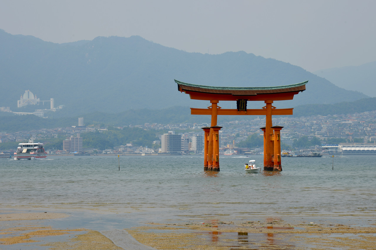 """Itsukushima Shrine (Japanese: 厳島神社 Itsukushima-jinja) is a Shinto shrine on the island of Itsukushima (popularly known as Miyajima), best known for its """"floating"""" torii gate. It is in the city of Hatsukaichi in Hiroshima Prefecture in Japan. The shrine complex is listed as a UNESCO World Heritage Site, and the Japanese government has designated several buildings and possessions as National Treasures.<br /> <br /> Itsukushima jinja was the chief Shinto shrine (ichinomiya) of Aki Province. The shrine has been destroyed many times, but the first shrine buildings were probably erected in the 6th century. The present shrine dates from the mid-16th century, and is believed to follow an earlier design from the 12th century.That design was established in 1168, when funds were provided by the warlord Taira no Kiyomori. Miyajima (宮島町) is a town located on the island of Itsukushima in Saeki District, Hiroshima Prefecture, Japan."""